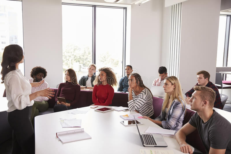 Group Of University Students Attending Lecture On Campus royalty free stock photography