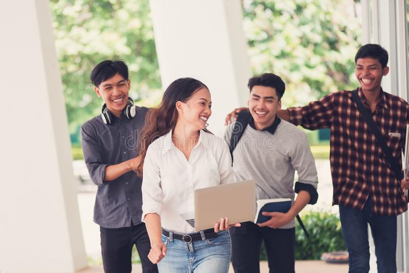 Group of university students walking outside together in campus, Happy Diverse students team concept. royalty free stock image