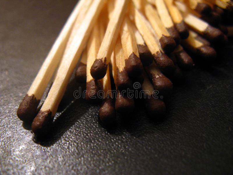 A group of unused matches scattered on the leather surface of the sofa royalty free stock images