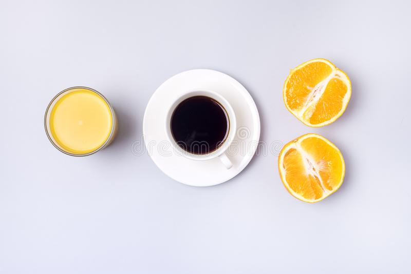 Group Useful Colorful Beverages Drink Coffee Orange Juice Ripe Oranges Flat Lay Still Life Table Top View Blue Background Minumal royalty free stock photos