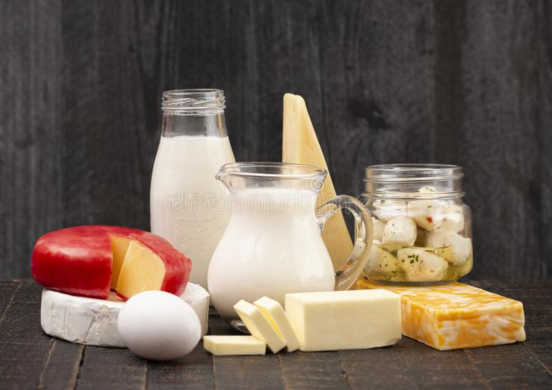 Group of Various Dairy Foods on a Rustic Wooden Table stock image