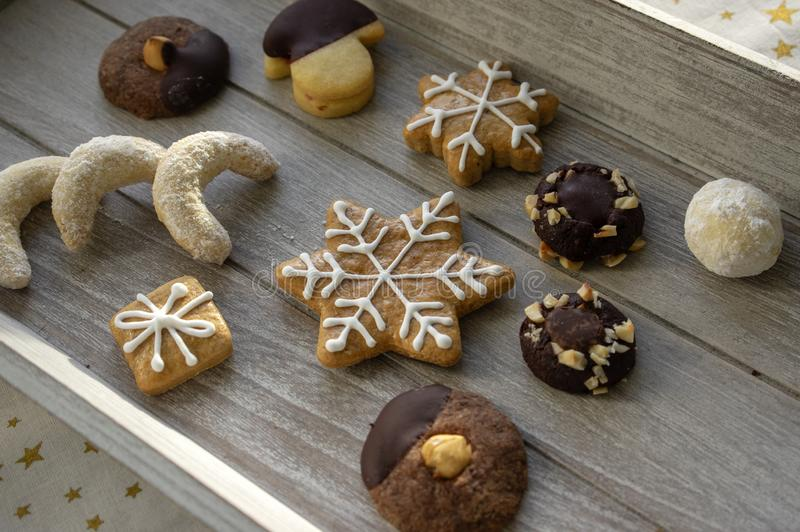 Group various kinds of delicious sweet Christmas cookies on light gray wood, tasty holiday breakfast royalty free stock photo