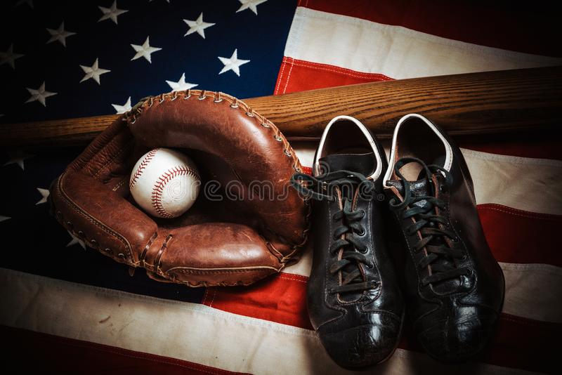 Vintage baseball gear on a American flag background royalty free stock photography