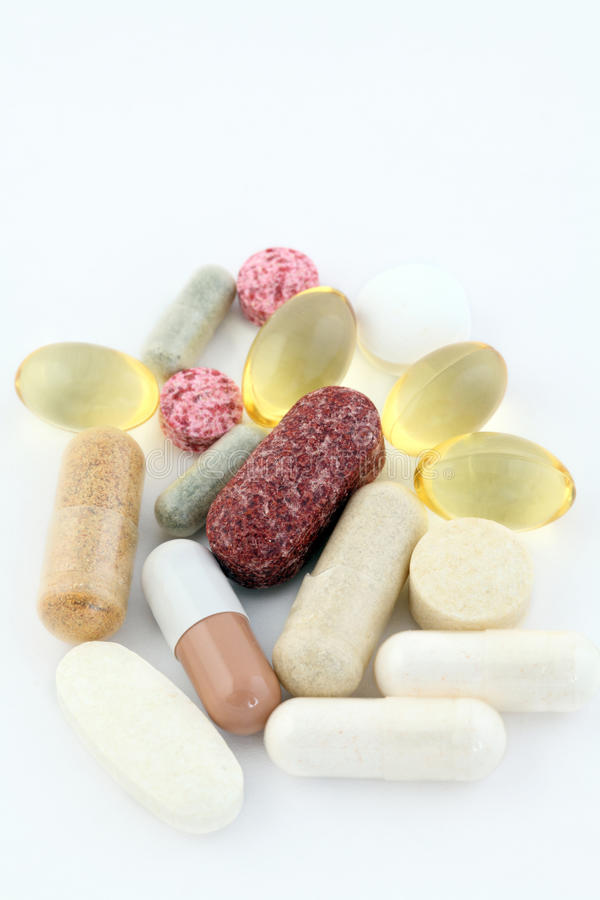 Group of vitamin pills food supplements. 17 vitamin and food supplement pills royalty free stock images