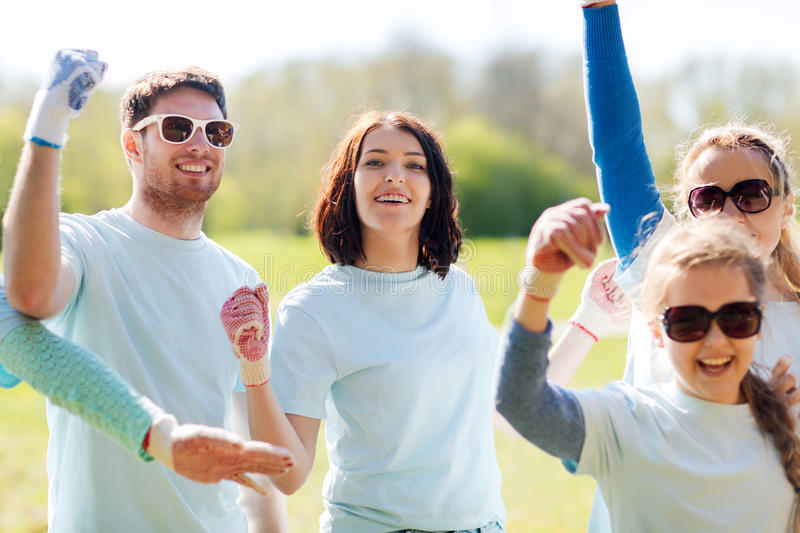 Group of volunteers celebrating success in park stock images