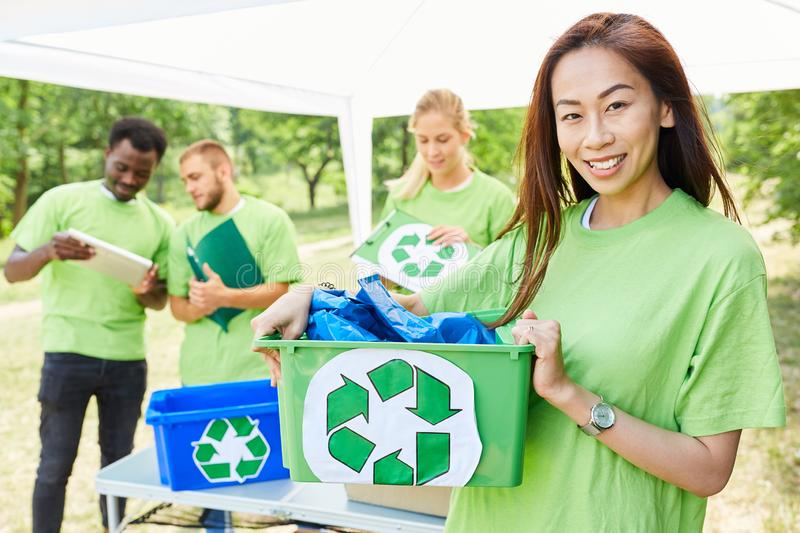 Group of volunteers collect garbage for recycling. Group volunteer collects garbage for recycling as environmental action stock photography
