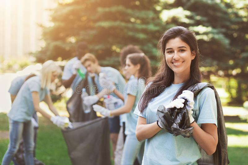 Group of volunteers with garbage bags cleaning park royalty free stock photo