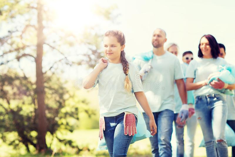 Group of volunteers with garbage bags in park royalty free stock photos