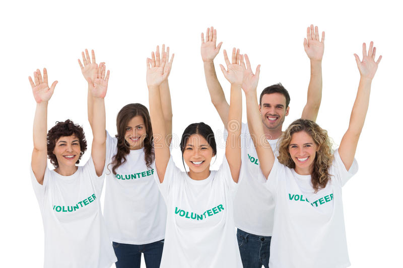 Group of volunteers raising arms stock images