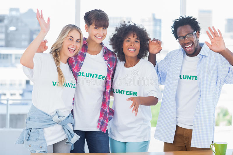 Group of volunteers standing together stock photo