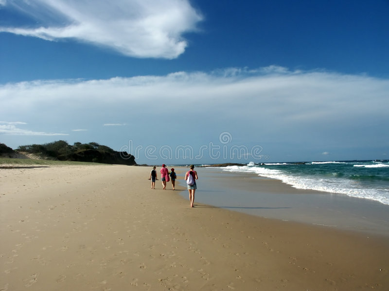 Group walking on beach royalty free stock photos
