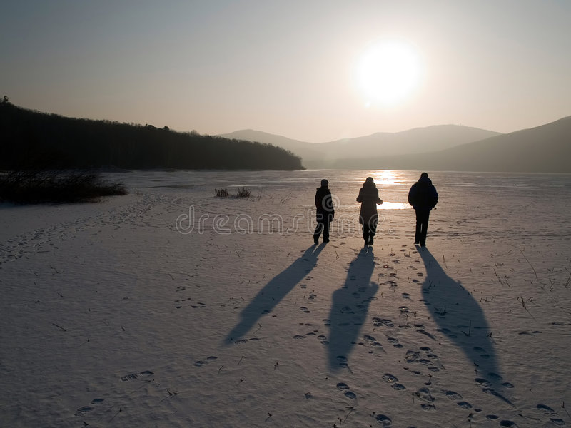 Group of walking friends stock images