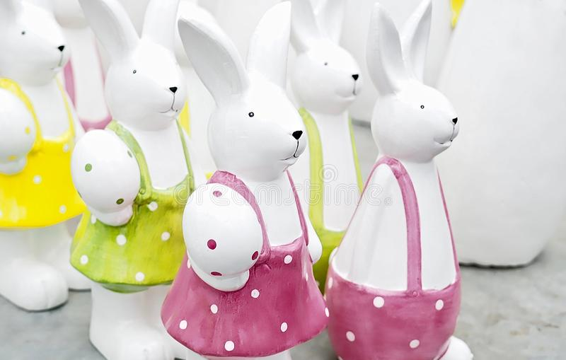 Group of white ceramic easter bunnies stock photo
