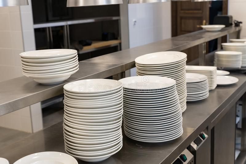 Group of white plates stacked together royalty free stock photo