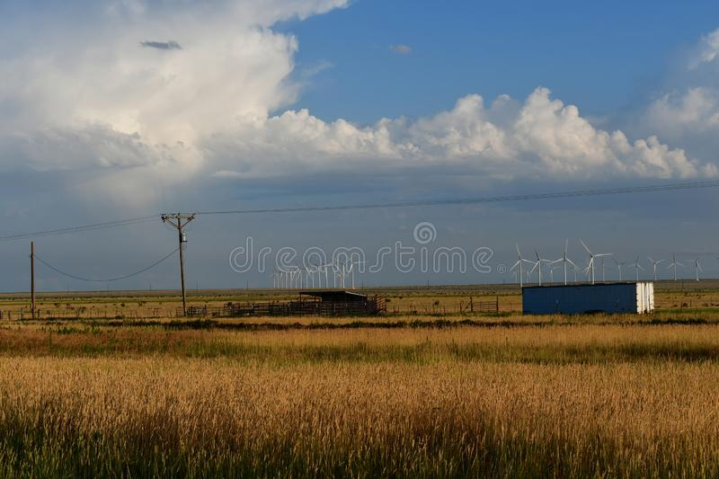 Texas Windmills against Blue Sky with White Clouds stock photo