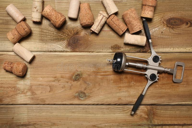 Group of wine bottle cork and a corkscrew on a wooden table with copy space for your text royalty free stock photos