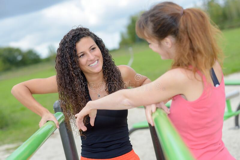 Group women chatting in park stock photography