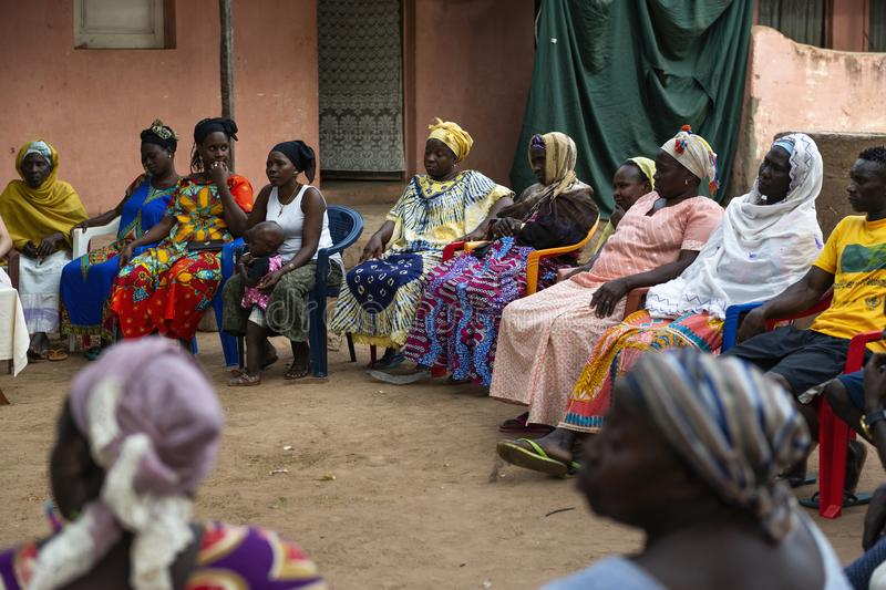Group of women at a community meeting in the city of Bissau, in Guinea-Bissau. Bissau, Republic of Guinea-Bissau - February 8, 2018: Group of women at a royalty free stock image
