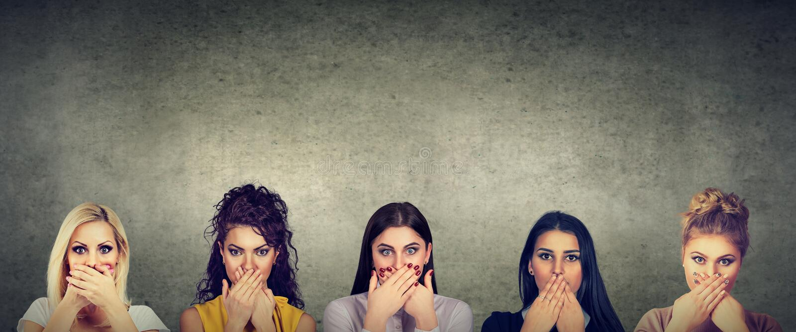 Group of women covering their mouth scared to speak out about abuse and domestic violence. Group of multicultural women covering their mouth scared to speak out royalty free stock photography