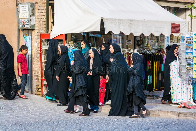 Yazd, Iran - May 17, 2017. Women in different kinds of black muslim dress royalty free stock images