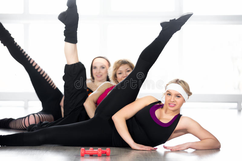 Group of women doing aerobics exercises in class royalty free stock image