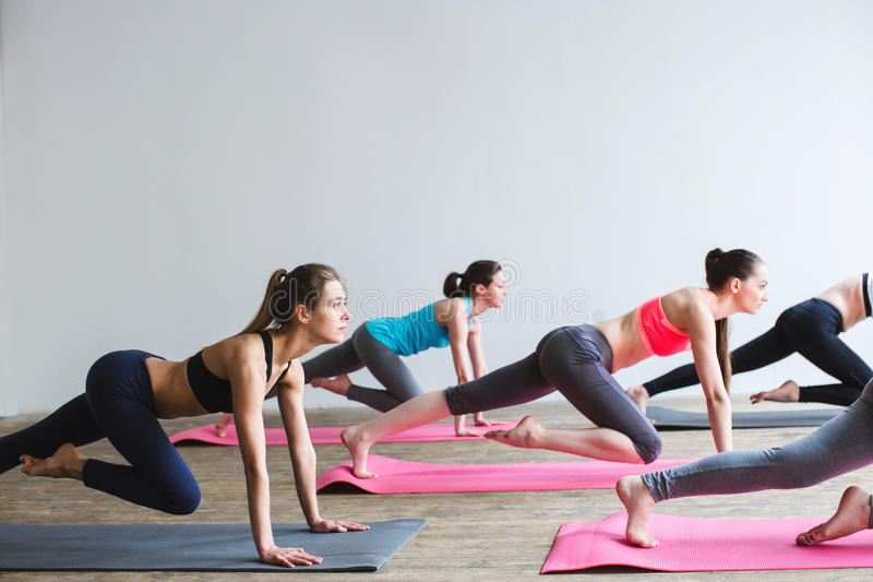 Group women on floor of sports gym doing push ups. royalty free stock images
