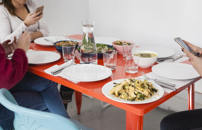 Smartphone using on the dinner table. royalty free stock images