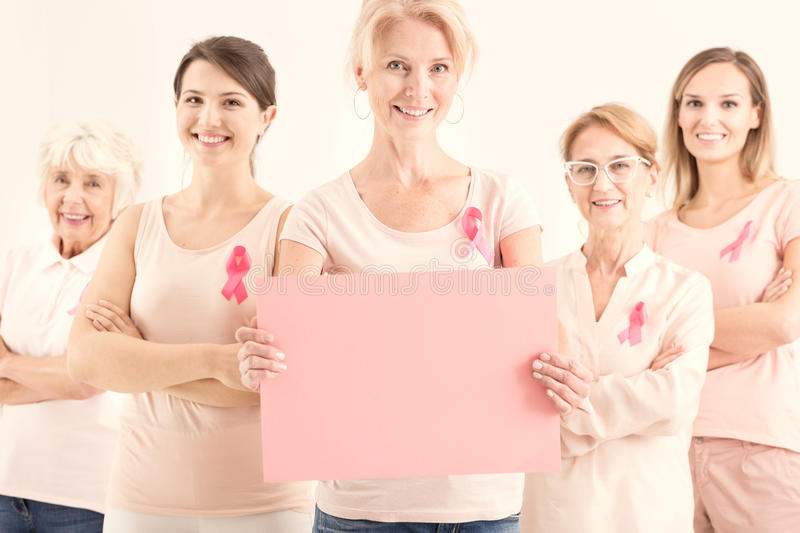 Group of women holding paper sheet royalty free stock photo