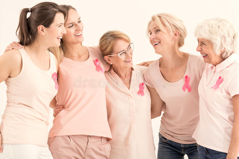 Group of women hugging royalty free stock photo