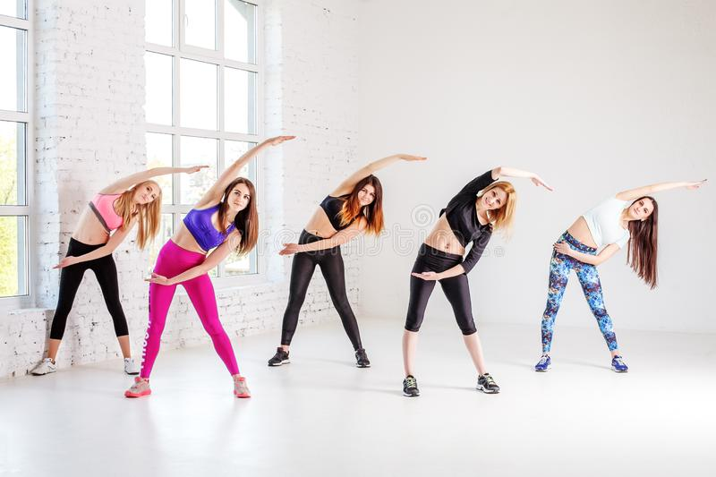 Group of women involved in charging the gym. The concept of sport and a healthy lifestyle. royalty free stock images