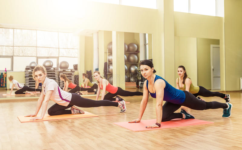 Group of women making step aerobics. In the fitness class stock image