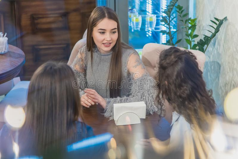 Group Of Women Meeting In Cafe. holidays, tourism, technology and internet - three beautiful girls. Three women enjoying stock images