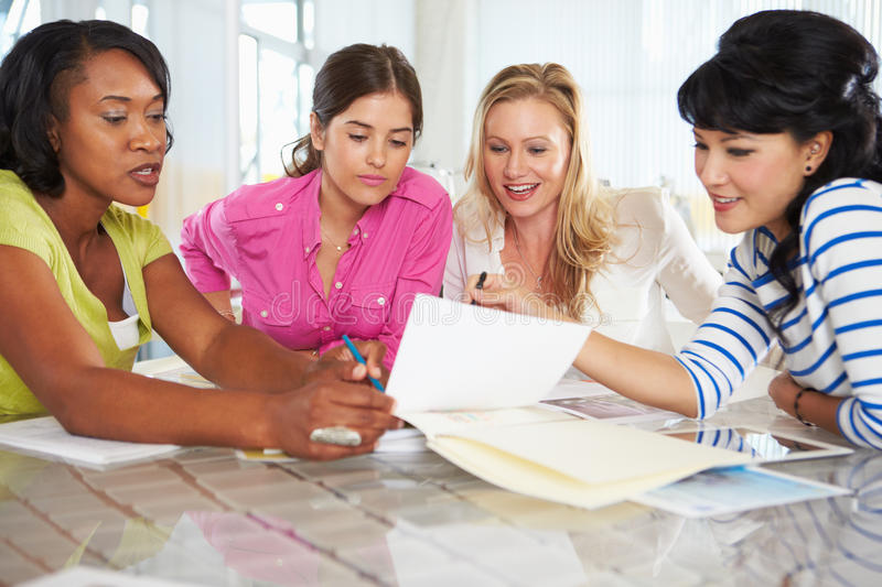 Group Of Women Meeting In Creative Office. Talking stock photo