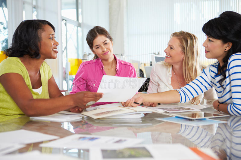 Group Of Women Meeting In Creative Office. Talking stock images