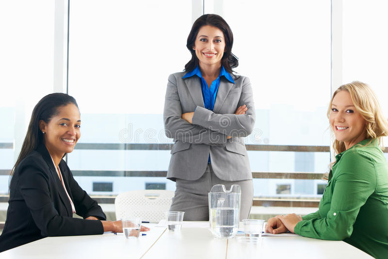 Group Of Women Meeting In Office. Group Of Business Women Having Meeting In Office Smiling To Camera stock photo