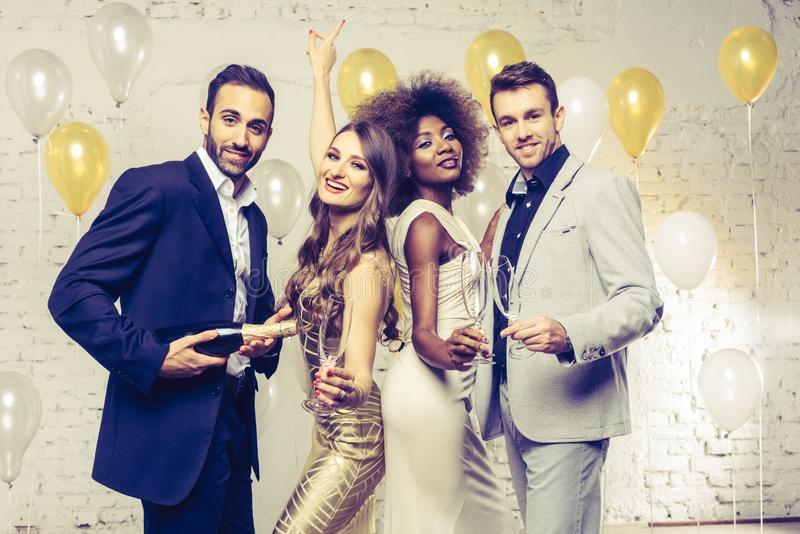 Group of women and men celebrating with champagne royalty free stock photo