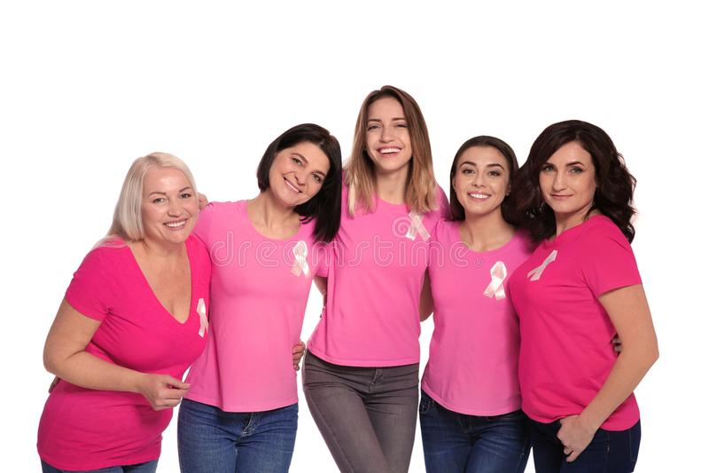 Group of women with silk ribbons on white. Breast cancer awareness concept. Group of women with silk ribbons on white background. Breast cancer awareness concept stock photography