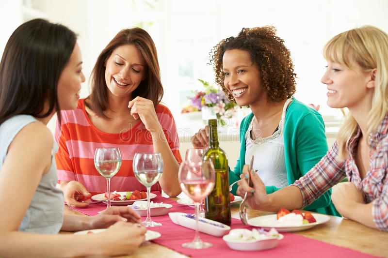 Download Group Of Women Sitting Around Table Eating Dessert Stock Image - Image: 35610507