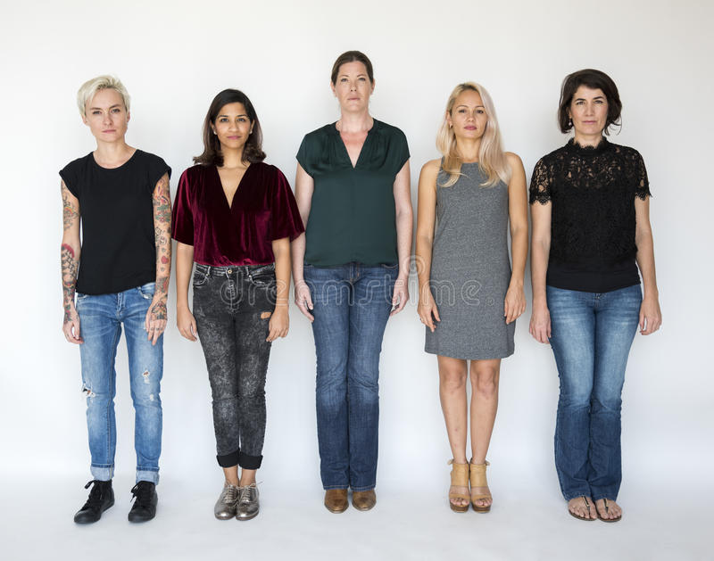 Group of Women Stand Together Serious Look royalty free stock images