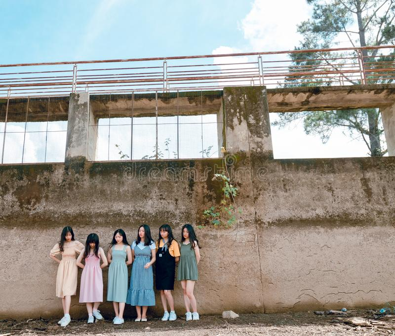 Group of Women Standing Infront of Wall royalty free stock image