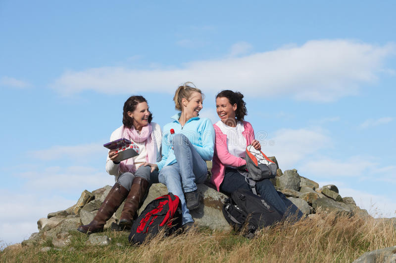 Group Of Women Stopping For Lunch On Countryside Walk. Chatting To Each Other royalty free stock photos