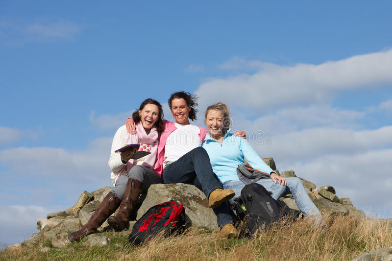 Group Of Women Stopping For Lunch On Countryside Walk. Smiling To Camera royalty free stock photos