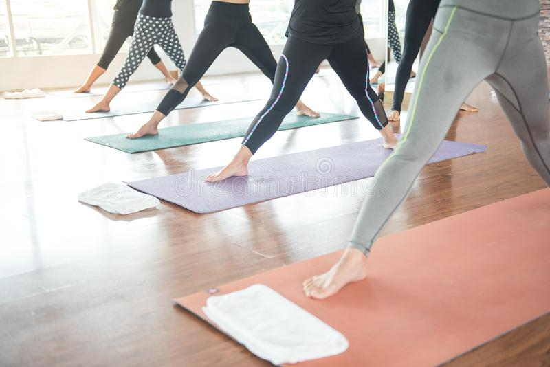 Group women stretching and practices yoga in a class, healthy li stock image