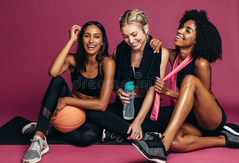 Group of women taking break after workout royalty free stock images