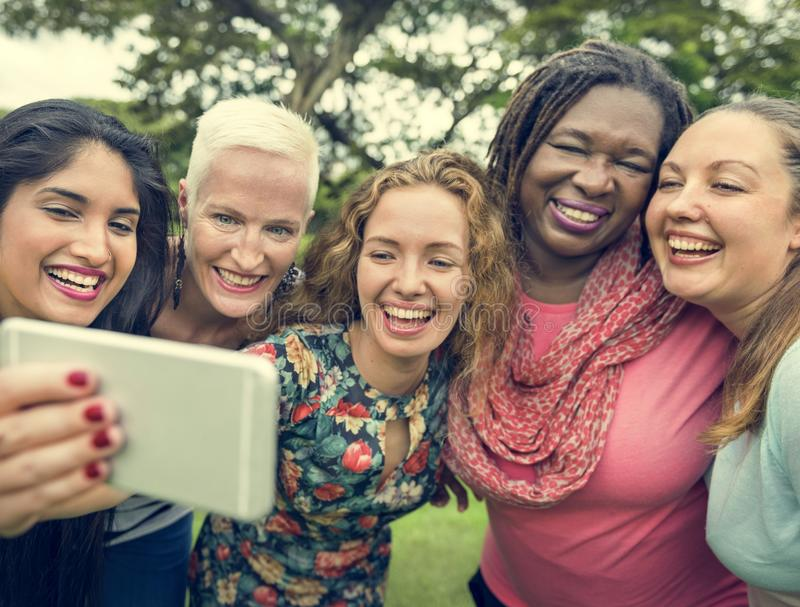 Group Of Women Taking Pictures Concept stock image