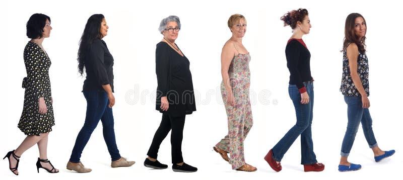 Group of women walking on white stock photos