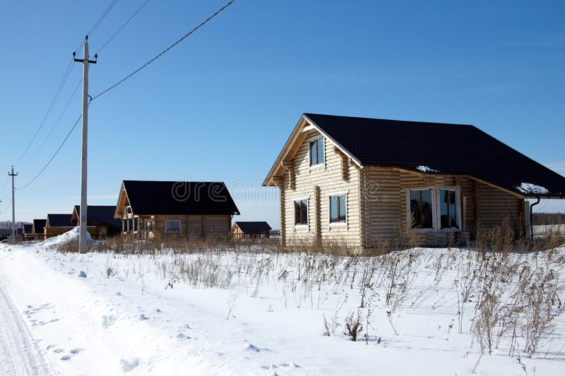 Group of wooden houses at winter, sunny day, no clouds royalty free stock photography