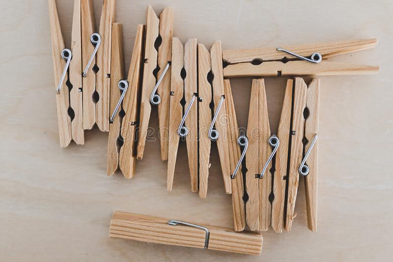 Group of wooden peg to hang the washing, sustainable living and alternative to plastic. Group of wooden peg to hang the washing, concept of sustainable living stock photos
