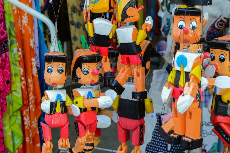 Group of wooden Pinocchio dolls royalty free stock images