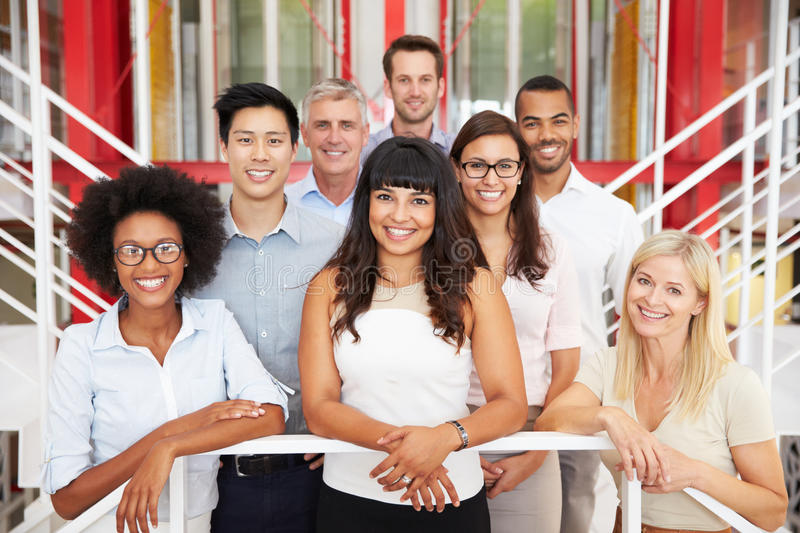 Group of work colleagues standing in an office lobby royalty free stock photography
